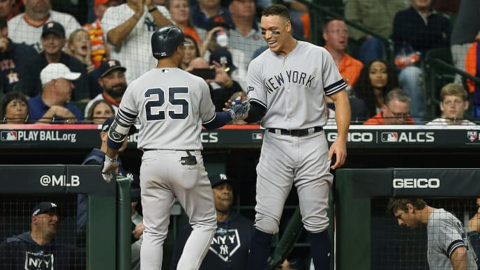 HOUSTON, TEXAS - OCTOBER 12:  Gleyber Torres #25 of the New York Yankees is congratulated by his teammate Aaron Judge #99 after hitting a solo home run against the Houston Astros during the sixth inning in game one of the American League Championship Series at Minute Maid Park on October 12, 2019 in Houston, Texas. (Photo by Bob Levey/Getty Images)