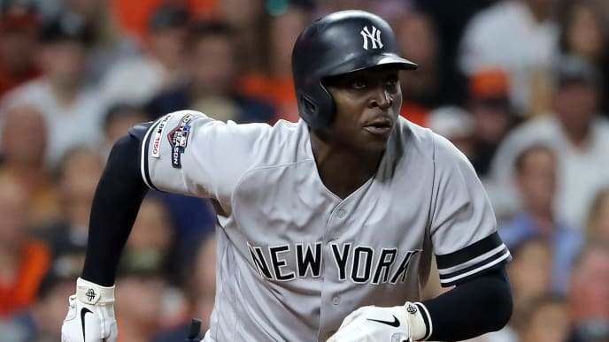 HOUSTON, TEXAS - OCTOBER 19:  Didi Gregorius #18 of the New York Yankees singles in the second inning against the Houston Astros in game six of the American League Championship Series at Minute Maid Park on October 19, 2019 in Houston, Texas. (Photo by Elsa/Getty Images)