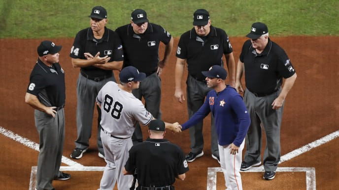HOUSTON, TX - OCTOBER 13:  Third base coach Phil Nevin #88 of the New York Yankees shakes hand with bench coach Joe Espada #19 of the Houston Astros before game two of the American League Championship Series at Minute Maid Park on October 13, 2019 in Houston, Texas.  (Photo by Tim Warner/Getty Images)