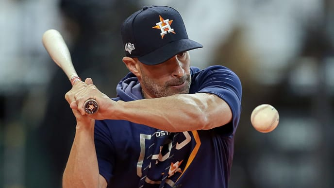 HOUSTON, TEXAS - OCTOBER 13:Bench coach Joe Espada #19 of the Houston Astros hit balls during batting practice before  game two of the American League Championship Series at Minute Maid Park on October 13, 2019 in Houston, Texas. (Photo by Bob Levey/Getty Images)