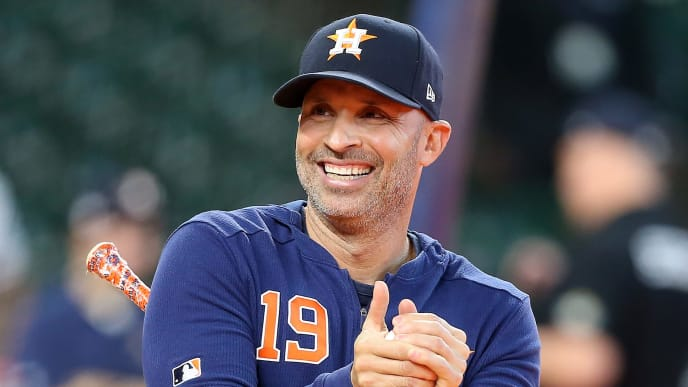 HOUSTON, TEXAS - OCTOBER 12:  Joe Espada #19 of the Houston Astros smiles during batting practice prior to game one of the American League Championship Series against the New York Yankees at Minute Maid Park on October 12, 2019 in Houston, Texas. (Photo by Bob Levey/Getty Images)
