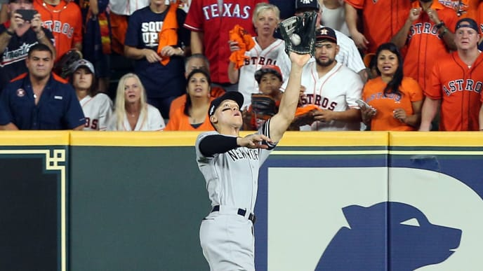HOUSTON, TEXAS - OCTOBER 19: Aaron Judge #99 of the New York Yankees makes a catch against the Houston Astros during Game 6 of the American League Championship Series at Minute Maid Park on October 19, 2019 in Houston, Texas. (Photo by Bob Levey/Getty Images)