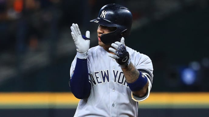 HOUSTON, TEXAS - OCTOBER 13: Gleyber Torres #25 of the New York Yankees reacts after hitting a single during the sixth inning against the Houston Astros in game two of the American League Championship Series at Minute Maid Park on October 13, 2019 in Houston, Texas. (Photo by Mike Ehrmann/Getty Images)