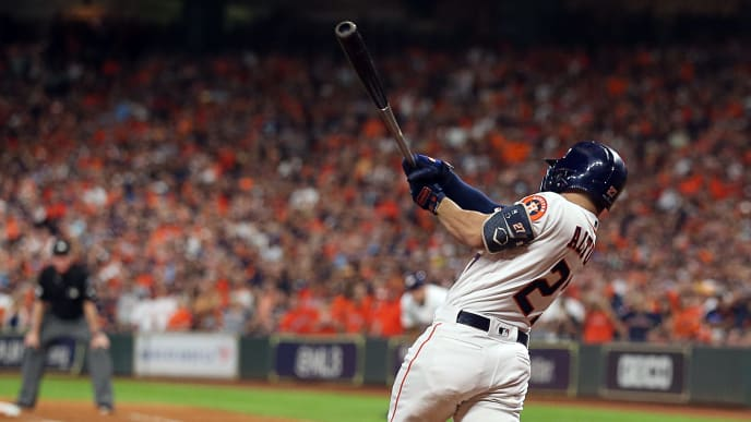 HOUSTON, TEXAS - OCTOBER 19: Jose Altuve #27 of the Houston Astros hits a walkoff home run in the ninth inning to beat the New York Yankees in Game 6 of the American League Championship Series at Minute Maid Park on October 19, 2019 in Houston, Texas. (Photo by Bob Levey/Getty Images)