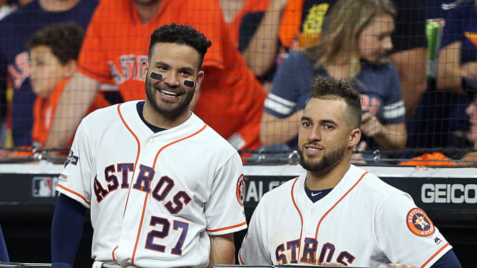 HOUSTON, TEXAS - OCTOBER 19: Jose Altuve #27 of the Houston Astros and George Springer #4 talk during Game 6 of the American League Championship Series against the New York Yankees at Minute Maid Park on October 19, 2019 in Houston, Texas. (Photo by Bob Levey/Getty Images)