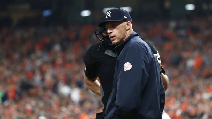 HOUSTON, TX - OCTOBER 20:  Manager Joe Girardi #28 of the New York Yankees talks with umpire Jim Reynolds #77 after a pitch during the second inning in Game Six of the American League Championship Series at Minute Maid Park on October 20, 2017 in Houston, Texas.  (Photo by Elsa/Getty Images)