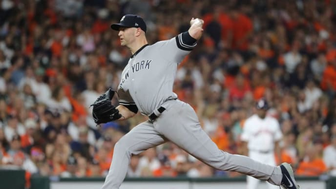 HOUSTON, TEXAS - OCTOBER 19:  J.A. Happ #34 of the New York Yankees delivers the pitch against the Houston Astros during the second inning in game six of the American League Championship Series at Minute Maid Park on October 19, 2019 in Houston, Texas. (Photo by Elsa/Getty Images)