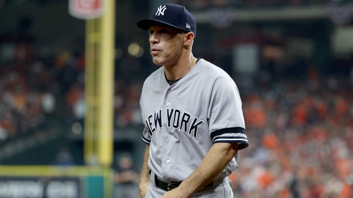 HOUSTON, TX - OCTOBER 21:  Joe Girardi #28 of the New York Yankees walks back to the dugout against the Houston Astros during the second inning in Game Seven of the American League Championship Series at Minute Maid Park on October 21, 2017 in Houston, Texas.  (Photo by Elsa/Getty Images)