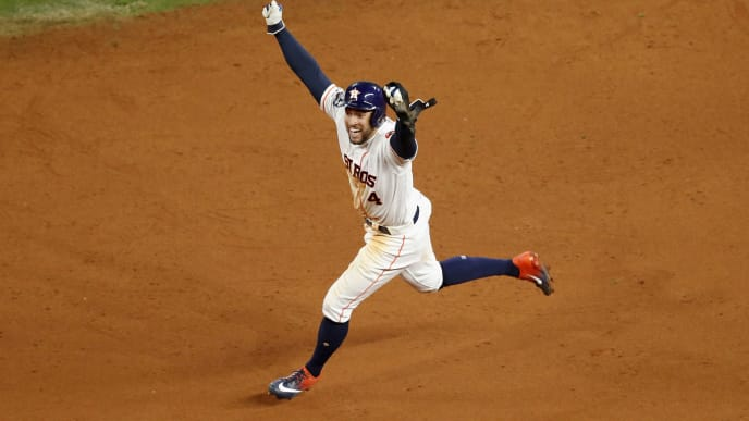 HOUSTON, TX - OCTOBER 19:  George Springer #4 of the Houston Astros celebrates as he runs the bases after a walk-off home run by Jose Altuve #27 in the ninth inning against the New York Yankees during Game Six of the League Championship Series at Minute Maid Park on October 19, 2019 in Houston, Texas.  (Photo by Tim Warner/Getty Images)