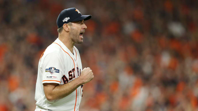 HOUSTON, TEXAS - OCTOBER 13: Justin Verlander #35 of the Houston Astros celebrates during the sixth inning against the New York Yankees in game two of the American League Championship Series at Minute Maid Park on October 13, 2019 in Houston, Texas. (Photo by Bob Levey/Getty Images)