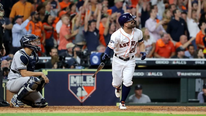 HOUSTON, TEXAS - OCTOBER 19:  Jose Altuve #27 of the Houston Astros hits a walk-off two-run home run to win game six of the American League Championship Series 6-4 against the New York Yankees at Minute Maid Park on October 19, 2019 in Houston, Texas. (Photo by Elsa/Getty Images)