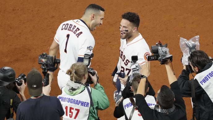 HOUSTON, TX - OCTOBER 19:  Carlos Correa #1 of the Houston Astros congratulates Jose Altuve #27 after a walk-off home run in the ninth inning against the New York Yankees during Game Six of the League Championship Series at Minute Maid Park on October 19, 2019 in Houston, Texas.  (Photo by Tim Warner/Getty Images)