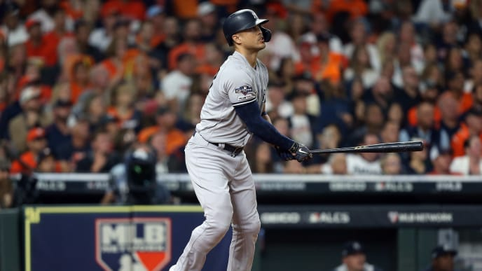 HOUSTON, TEXAS - OCTOBER 12:  Giancarlo Stanton #27 of the New York Yankees hits a solo home run against the Houston Astros during the sixth inning in game one of the American League Championship Series at Minute Maid Park on October 12, 2019 in Houston, Texas. (Photo by Bob Levey/Getty Images)