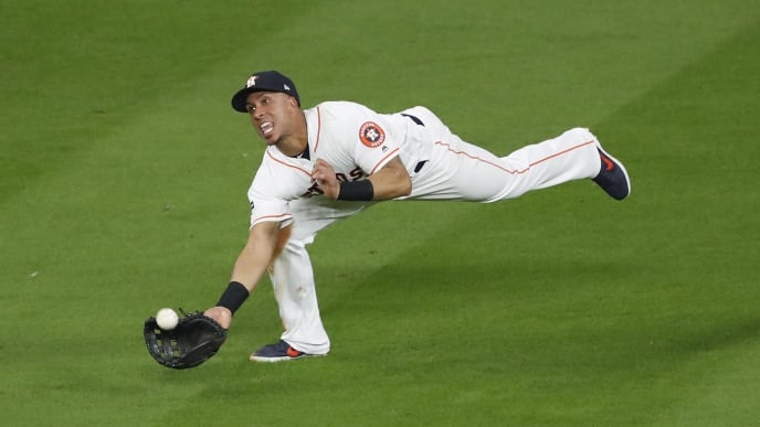 HOUSTON, TX - OCTOBER 19:  Michael Brantley #23 of the Houston Astros makes a diving catch in the seventh inning against the New York Yankees during Game Six of the League Championship Series at Minute Maid Park on October 19, 2019 in Houston, Texas.  (Photo by Tim Warner/Getty Images)