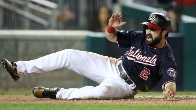 WASHINGTON, DC - OCTOBER 14: Adam Eaton #2 of the Washington Nationals celebrates as he slides home to score on an RBI double hit by teammate Anthony Rendon #6 in the third inning of game three of the National League Championship Series against the St. Louis Cardinals at Nationals Park on October 14, 2019 in Washington, DC. (Photo by Rob Carr/Getty Images)