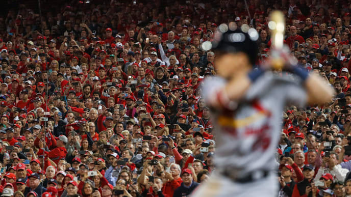 WASHINGTON, DC - OCTOBER 15: Fans use their cell phones and cameras to record the last out of the of game four of the National League Championship Series between the St. Louis Cardinals and the Washington Nationals at Nationals Park on October 15, 2019 in Washington, DC. (Photo by Patrick Smith/Getty Images)