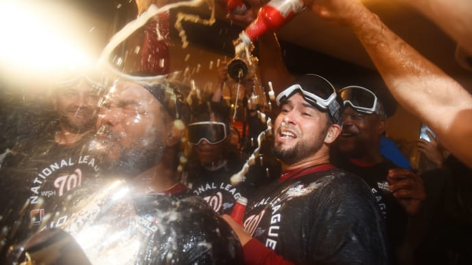 WASHINGTON, DC - OCTOBER 15: Howie Kendrick #47 of the Washington Nationals celebrates with teammates in the clubhouse after they won game four and the National League Championship Series against the St. Louis Cardinals at Nationals Park on October 15, 2019 in Washington, DC. (Photo by Will Newton/Getty Images)