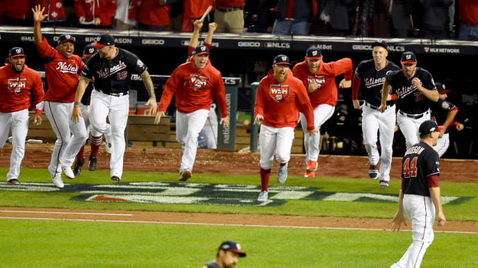 WASHINGTON, DC - OCTOBER 15: The Washington Nationals bench runs on to the field after defeating the St. Louis Cardinals for Game Four of the National League Championship Series at Nationals Park on October 15, 2019 in Washington, DC. (Photo by Will Newton/Getty Images)