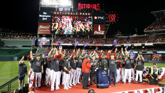 WASHINGTON, DC - OCTOBER 15: The Washington Nationals celebrate winning game four and the National League Championship Series against the St. Louis Cardinals at Nationals Park on October 15, 2019 in Washington, DC. (Photo by Rob Carr/Getty Images)