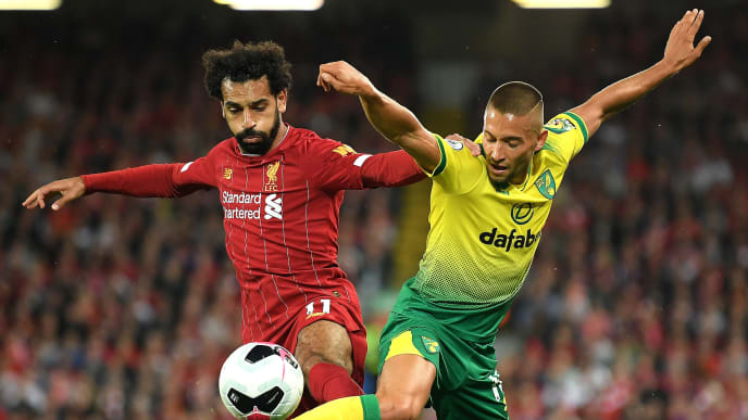 LIVERPOOL, ENGLAND - AUGUST 09: Moritz Leitner of Norwich City and Mohamed Salah of Liverpool during the Premier League match between Liverpool FC and Norwich City at Anfield on August 09, 2019 in Liverpool, United Kingdom. (Photo by Michael Regan/Getty Images)