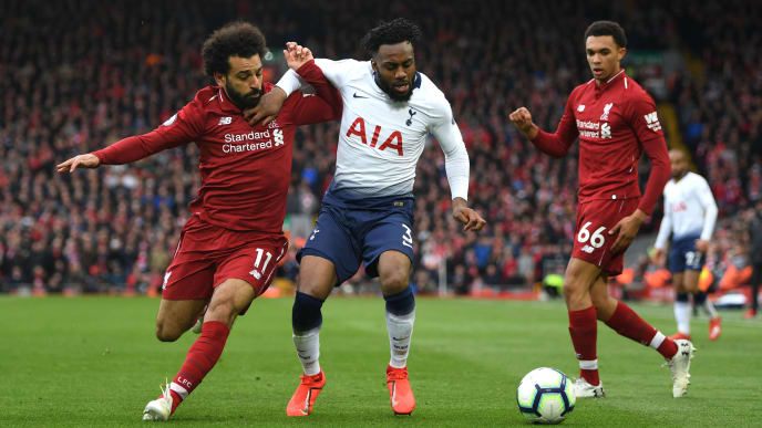 LIVERPOOL, ENGLAND - MARCH 31:  Danny Rose of Tottenham Hotspur is tackled by Mohamed Salah of Liverpool during the Premier League match between Liverpool FC and Tottenham Hotspur at Anfield on March 31, 2019 in Liverpool, United Kingdom. (Photo by Shaun Botterill/Getty Images)