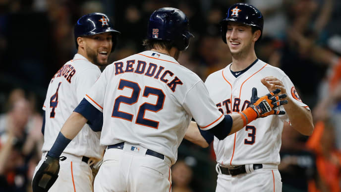 HOUSTON, TX - SEPTEMBER 22:  Kyle Tucker #3 of the Houston Astros is congratulated by Josh Reddick #22 and George Springer #4 as he scores in the eighth inning against the Los Angeles Angels of Anaheim at Minute Maid Park on September 22, 2018 in Houston, Texas.  (Photo by Bob Levey/Getty Images)