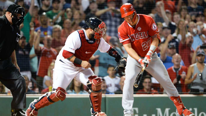 BOSTON, MA - AUGUST 8: Sandy Leon #3 of the Boston Red Sox tags Mike Trout #27 of the Los Angeles Angels of Anaheim for the final out at Fenway Park on August 8, 2019 in Boston, Massachusetts. (Photo by Kathryn Riley/Getty Images)