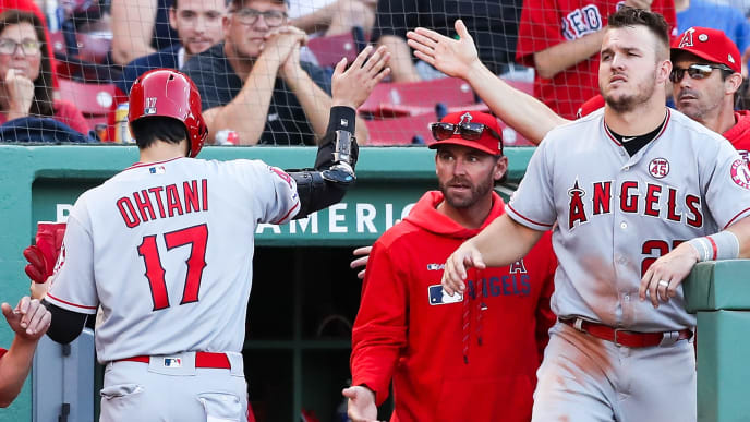 BOSTON, MA - AUGUST 10:  Shohei Ohtani #17 of the Los Angeles Angels returns to the dugout after scoring in the seventh inning of a game against the Boston Red Sox at Fenway Park on August 10, 2019 in Boston, Massachusetts.  (Photo by Adam Glanzman/Getty Images)