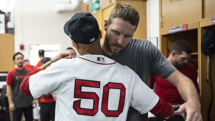 BOSTON, MA - AUGUST 8: Chris Sale #41of the Boston Red Sox hugs Mookie Betts #50 in the clubhouse after a game against the Los Angeles Angels of Anaheim on August 8, 2019 at Fenway Park in Boston, Massachusetts. (Photo by Billie Weiss/Boston Red Sox/Getty Images)