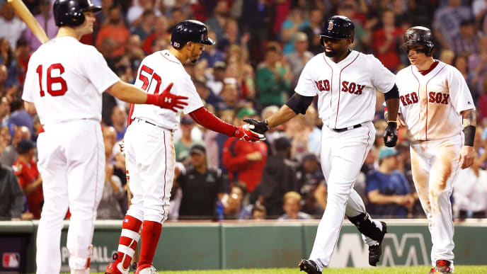 BOSTON, MA - JUNE 28:  Jackie Bradley Jr. #19 high fives Mookie Betts #50 of the Boston Red Sox after hitting a two-run home run in the seventh inning a game against the Los Angeles Angels at Fenway Park on June 28, 2018 in Boston, Massachusetts.  (Photo by Adam Glanzman/Getty Images)