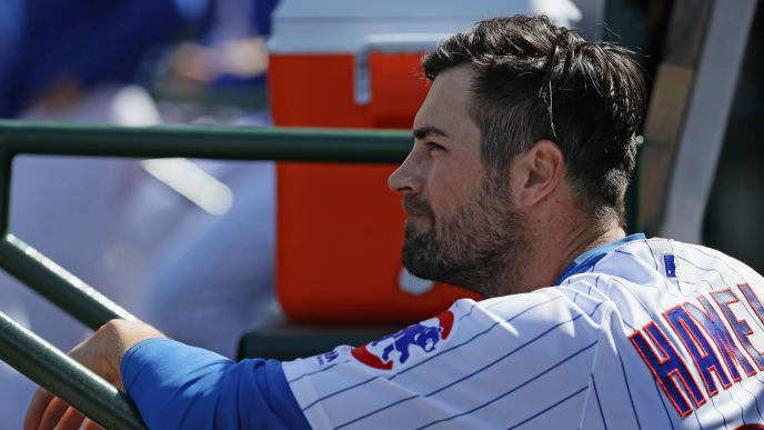 CHICAGO, ILLINOIS - APRIL 12: Cole Hamels #35 of the Chicago Cubs watches from the dugout as teammates take on the Los Angeles Angels at Wrigley Field on April 12, 2019 in Chicago, Illinois. The Cubs defeated the Angels 5-1. (Photo by Jonathan Daniel/Getty Images)