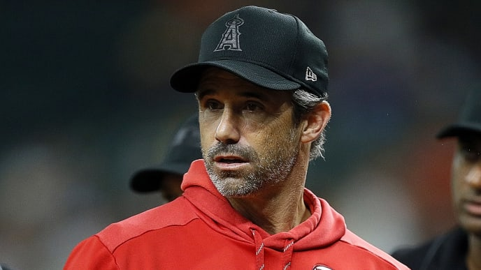 HOUSTON, TEXAS - AUGUST 23: Manager Brad Ausmus #12 of the Los Angeles Angels at Minute Maid Park on August 23, 2019 in Houston, Texas. Teams are wearing special color schemed uniforms with players choosing nicknames to display for Players' Weekend. (Photo by Bob Levey/Getty Images)