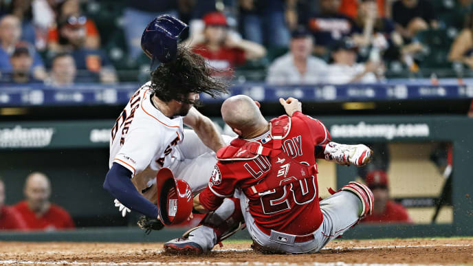 HOUSTON, TEXAS - JULY 07: Jake Marisnick #6 of the Houston Astros collides with catcher Jonathan Lucroy #20 of the Los Angeles Angels of Anaheim as he attempts to score in the eighth inning at Minute Maid Park on July 07, 2019 in Houston, Texas.  Marisnick was called out under the home plate collision rule. (Photo by Bob Levey/Getty Images)