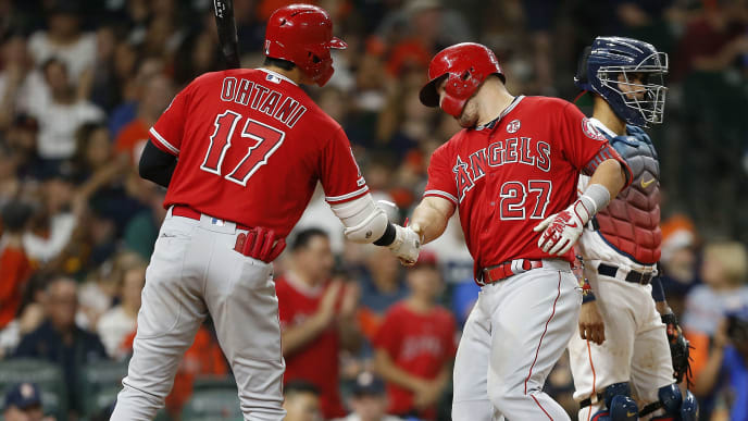 HOUSTON, TEXAS - JULY 05:  Mike Trout #27 of the Los Angeles Angels of Anaheim receives congratulations from Shohei Ohtani #17 after hitting a home run in the eighth inning Houston Astros at Minute Maid Park on July 05, 2019 in Houston, Texas. (Photo by Bob Levey/Getty Images)