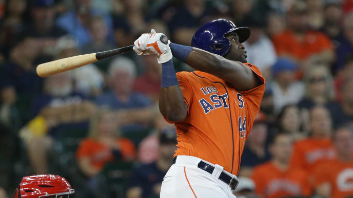 HOUSTON, TEXAS - SEPTEMBER 22: Yordan Alvarez #44 of the Houston Astros doubles in the third inning against the Los Angeles Angels at Minute Maid Park on September 22, 2019 in Houston, Texas. (Photo by Bob Levey/Getty Images)