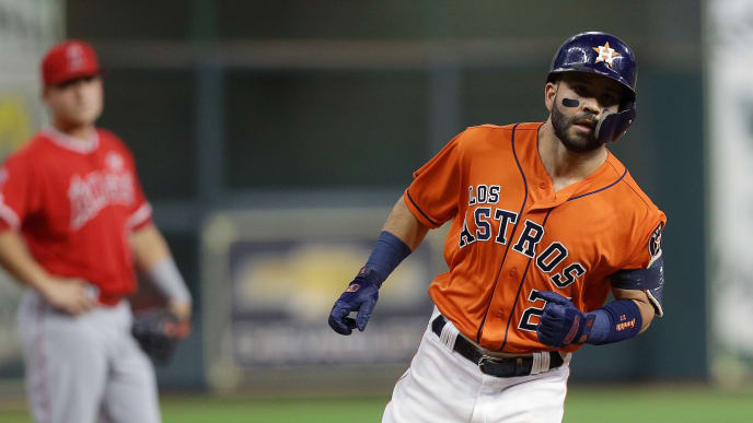 HOUSTON, TEXAS - SEPTEMBER 20: Jose Altuve #27 of the Houston Astros hits a home run in the first inning against the Los Angeles Angels at Minute Maid Park on September 20, 2019 in Houston, Texas. (Photo by Bob Levey/Getty Images)