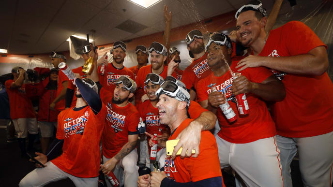 HOUSTON, TEXAS - SEPTEMBER 22: The Houston Astros celebrate winning the American League West Division after defeating the Los Angeles Angels at Minute Maid Park on September 22, 2019 in Houston, Texas. (Photo by Bob Levey/Getty Images)
