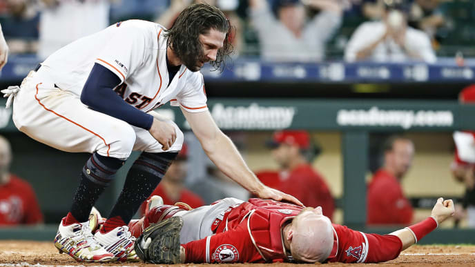 HOUSTON, TEXAS - JULY 07: Jake Marisnick #6 of the Houston Astros checks on Jonathan Lucroy #20 of the Los Angeles Angels of Anaheim after they collided in the eighth inning on a play at the plate at Minute Maid Park on July 07, 2019 in Houston, Texas. Marsnick was ruled out on the  home plate collision rule. (Photo by Bob Levey/Getty Images)