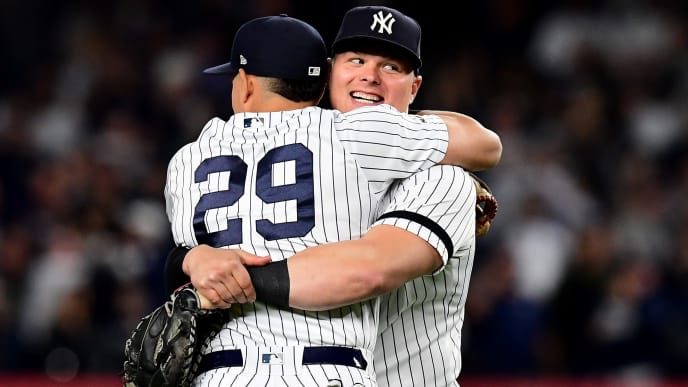 NEW YORK, NEW YORK - SEPTEMBER 19: Gio Urshela #29 and Luke Voit #45 of the New York Yankees hug after their 9-1 win over the Los Angeles Angels at Yankee Stadium on September 19, 2019 in the Bronx borough of New York City. (Photo by Emilee Chinn/Getty Images)