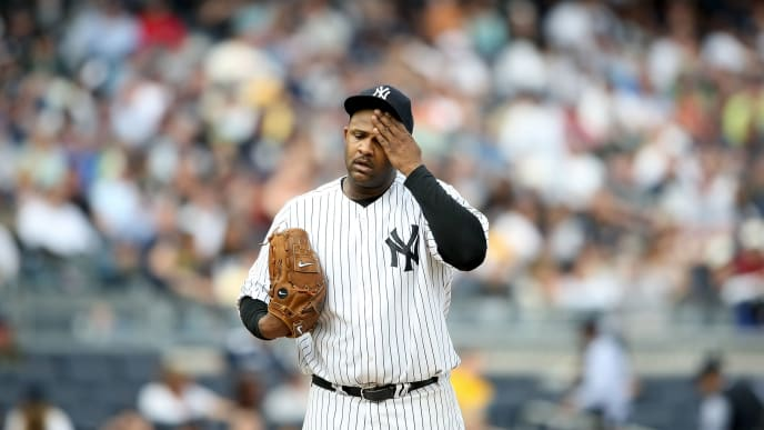 NEW YORK - MAY 02:  CC Sabathia #52 of the New York Yankees wipes sweat from his forehead against the Los Angeles Angels of Anaheim at Yankee Stadium on May 2, 2009 in the Bronx borough of New York City.  (Photo by Nick Laham/Getty Images)