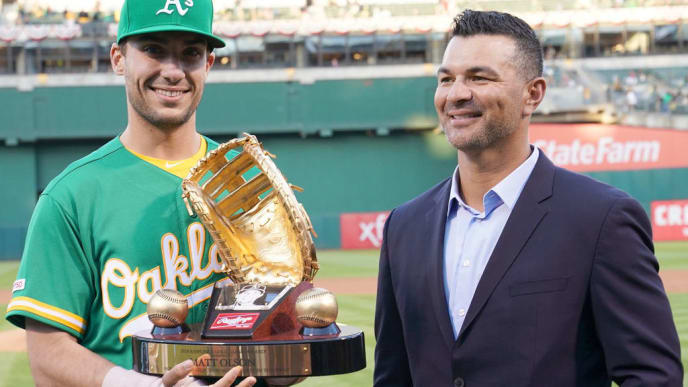 OAKLAND, CA - MARCH 29:  Matt Olson #28 of the Oakland Athletics is presented with his Rawlings 2018 Gold Glove Award by former Oakland Athletics gold glover Eric Chavez prior to the start of his game against the Los Angeles Angels of Anaheim at Oakland-Alameda County Coliseum on March 29, 2019 in Oakland, California.  (Photo by Thearon W. Henderson/Getty Images)