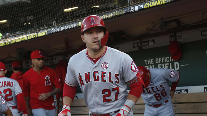 OAKLAND, CA - SEPTEMBER 4: Mike Trout #27 of the Los Angeles Angels of Anaheim stands in the dugout prior to the game against the Oakland Athletics at the Oakland-Alameda County Coliseum on September 4, 2019 in Oakland, California. The Athletics defeated the Angels 4-0. (Photo by Michael Zagaris/Oakland Athletics/Getty Images)