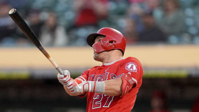 OAKLAND, CA - SEPTEMBER 03:  Mike Trout #27 of the Los Angeles Angels of Anaheim swings and watches the flight of his ball as he hits a solo home run against the Oakland Athletics in the top of the first inning at Ring Central Coliseum on September 3, 2019 in Oakland, California.  (Photo by Thearon W. Henderson/Getty Images)