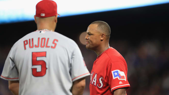 ARLINGTON, TX - APRIL 30:  Adrian Beltre #29 of the Texas Rangers talks with Albert Pujols #5 of the Los Angeles Angels at Globe Life Park in Arlington on April 30, 2016 in Arlington, Texas.  (Photo by Ronald Martinez/Getty Images)