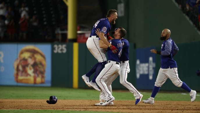 ARLINGTON, TEXAS - AUGUST 21:  Hunter Pence #24 of the Texas Rangers celebrates a walk off hit against the Los Angeles Angels at Globe Life Park in Arlington on August 21, 2019 in Arlington, Texas. (Photo by Ronald Martinez/Getty Images)