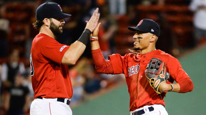 BOSTON, MA - AUGUST 9: Mitch Moreland #18 high fives Mookie Betts #50 of the Boston Red Sox after beating the Los Angeles Angels at Fenway Park on August 9, 2019 in Boston, Massachusetts. (Photo by Kathryn Riley/Getty Images)