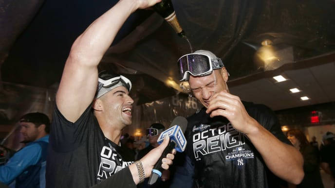 NEW YORK, NEW YORK - SEPTEMBER 19:  Tyler Wade #14 and Aaron Judge #99 of the New York Yankees celebrate after the New York Yankees clinched the American League Division title with the 9-1 win over the Los Angeles Angels at Yankee Stadium on September 19, 2019 in Bronx borough of New York City. (Photo by Elsa/Getty Images)