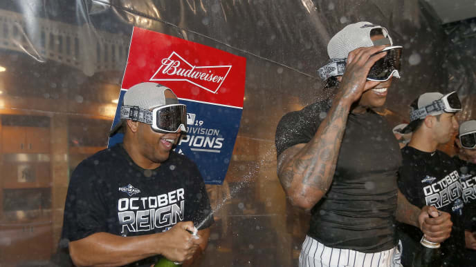 NEW YORK, NEW YORK - SEPTEMBER 19:  Edwin Encarnacion #30 and Aroldis Chapman #54 of the New York Yankees celebrate after the New York Yankees clinched the American League East division title at Yankee Stadium on September 19, 2019 in Bronx borough of New York City. (Photo by Elsa/Getty Images)