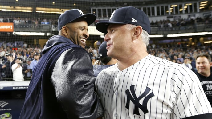 NEW YORK, NEW YORK - SEPTEMBER 19: CC Sabathia #52 and third base coach Phil Nevin #88 of the New York Yankees celebrate the 9-1 win over the Los Angeles Angels to clinch of the American League East title at Yankee Stadium on September 19, 2019 in Bronx borough of New York City. (Photo by Elsa/Getty Images)