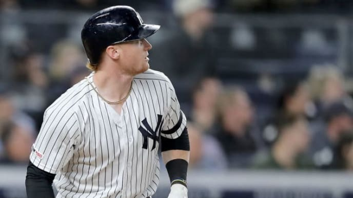 NEW YORK, NEW YORK - SEPTEMBER 19:  Clint Frazier #77 of the New York Yankees watches his two run home run in the eighth inning against the Los Angeles Angels at Yankee Stadium on September 19, 2019 in Bronx borough of New York City. (Photo by Elsa/Getty Images)